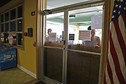 October 7, 2016 - Palm Bay, FL, USA - Workers and residents at Tropical Inn Resort, a hotel and rehab facility, board up the front door of the hotel in preparation for Hurricane Matthew on Oct. 6, 2016 in Palm Bay, Fla. (Credit Image: © Carl Juste/TNS via ZUMA Wire)
