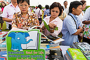 "23 APRIL 2013 - BANGKOK, THAILAND:  Thais browse among the books being donated to Thai literacy projects during the opening ceremony to mark Bangkok as the World Book Capital City 2013. UNESCO awarded Bangkok the title. Bangkok is the 13th city to assume the title of ""World Book Capital"", taking over from Yerevan, Armenia. Bangkok Governor Suhumbhand Paribatra announced plans that the Bangkok Metropolitan Administration (BMA) intends to encourage reading among Thais. The BMA runs 37 public libraries in the city and has modernised 14 of them. It plans to build 10 more public libraries every year. Port Harcourt, Nigeria will be the next World Book Capital in 2014. .PHOTO BY JACK KURTZ"
