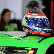 Danica Patrick, driver of the #7 GoDaddy Chevrolet stands in the garage area during practice for the 60th Annual NASCAR Daytona 500 auto race at Daytona International Speedway on Friday, February 16, 2018 in Daytona Beach, Florida.  (Alex Menendez via AP)