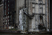 SHOT 10/5/15 3:52:06 PM - Just south of downtown Buffalo,N.Y., near the city's First Ward, lies an area of abandoned grain elevators known as Silo City. The grain silos sit in a state of half-decay and serve as reminders of of Buffalo's successful past. The city serves as the western terminus for the Erie Canal, which doesn't mean much today as most of the grain from the Midwest moves east through the Saint Lawrence Seaway, but in the 19th and 20th centuries there was no other option but to move the harvests through the Canal. As a result, Buffalo became one of the United States' economic powerhouses. But once the city's strategic position was made useless by the Seaway, manufacturing in the city mostly dried up. The massive grain elevators were left abandoned, relics of a better time. Buffalo, N.Y. is the second most populous city in the state of New York and is located in Western New York on the eastern shores of Lake Erie and at the head of the Niagara River. By 1900, Buffalo was the 8th largest city in the country, and went on to become a major railroad hub, the largest grain-milling center in the country and the home of the largest steel-making operation in the world. The latter part of the 20th Century saw a reversal of fortunes: by the year 1990 the city had fallen back below its 1900 population levels. (Photo by Marc Piscotty / © 2015)