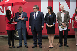 © Licensed to London News Pictures. 10/05/2016. London, UK. Labour Party leader Jeremy Corbyn (R) and Alan Johnson (L), Chairman of 'Labour In for Britain' unveil their campaign bus.  Labour deputy Tom Watson (3L) and Gloria De Piero (2R), Shadow Minister for Young People and Voter Registration, also attended. Photo credit: Peter Macdiarmid/LNP
