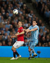 MANCHESTER, ENGLAND - Monday, April 30, 2012: Manchester City's Gareth Barry in action against Manchester United's Ryan Giggs during the Premiership match at the City of Manchester Stadium. (Pic by David Rawcliffe/Propaganda)