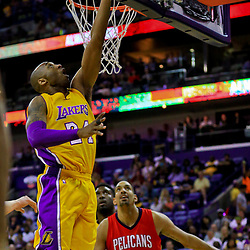 Apr 8, 2016; New Orleans, LA, USA; Los Angeles Lakers forward Kobe Bryant (24) shoots over New Orleans Pelicans center Alexis Ajinca (42) during the first quarter of a game at the Smoothie King Center. Mandatory Credit: Derick E. Hingle-USA TODAY Sports