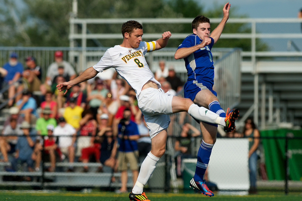 Catamounts defenseman Joe Losier (8) fights for the ball during the men's soccer game between the Central Connecticut State University Blue Devils and the Vermont Catamounts at Virtue Field on Friday afternoon September 7, 2012 in Burlington, Vermont.