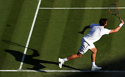 Ernests Gulbis in action on day six of the Wimbledon Championships at the All England Lawn Tennis and Croquet Club, Wimbledon.