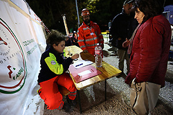 NORCIA, Oct. 31, 2016 (Xinhua) -- A resident registers and prepares to have her dinner at the relief camp in Norcia, central Italy, on Oct. 30, 2016. A 6.5-magnitude earthquake hit central Italy on Sunday, causing no victims, but destroying precious historic buildings. .(Xinhua/Jin Yu) (gj) (Credit Image: © Jin Yu/Xinhua via ZUMA Wire)