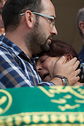 © licensed to London News Pictures. Eskisehir/TURKEY 10/07/2013. Brother and mother of Ali Ismail Korkmaz, a 19-year-old university student who was killed by Turkish riot police whilst supporting an anti-government demonstration, mourning at his funeral procession in Eskisehir, Turkey. Ali suffered brain injury for more 38 days until he die and he has become the 5th protester who died in the recent demonstrations in Turkey which started with Istanbul's Gezi Park movement. Photo credit: Tolga Akmen/LNP