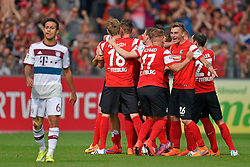 Football: Germany, 1. Bundesliga, SC Freiburg - FC Bayern Muenchen, Freiburg - 16.05.2015,<br /> Thiago (Bayern) dejected, Players of Freiburg celebrating at the end of the match<br /> <br /> © pixathlon<br /> <br /> +++ NED out !!! +++