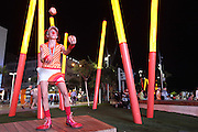 Open-air circus Clown juggles balls outdoors