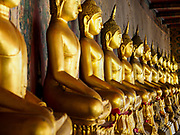 """11 SEPTEMBER 2017 - BANGKOK, THAILAND: Statues of the Buddha at Wat Arun. Renovations are nearly finished at Wat Arun on the Thonburi side of the Chao Phraya River in Bangkok. Wat Arun is famous for its Khmer style main """"prang"""" (chedi). It was originally built in the Ayutthaya Period and rebuilt to its current form in the time of Rama II.      PHOTO BY JACK KURTZ"""