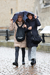 © Licensed to London News Pictures. 08/02/2019. London, UK.  Two women hold onto their umbrella as they walk in wet and windy weather near the Tower of London. Storm Erik is the first named storm of 2019 with gale force winds and wet weather affecting most of the UK today. Photo credit: Vickie Flores/LNP