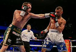Sean McGoldrick (left) in action against Sean Cairns during their super bantamweight at the Copper Box Arena, London.