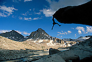 Hans Florine hanging from a granite spire above Sapphire Lake in Evolution Valley, along the John Muir Trail in California's High Sierra Nevada Mountains, Sequoia/Kings Canyon National Park, California