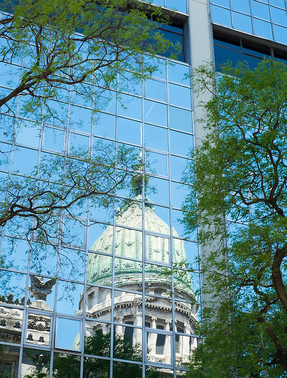 View of historical dome on the Capitol Building on Buenos Aires reflected into a modern building.