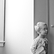 Cute little boy making a face in his room.