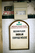 A sign for the Indian Coffee House, Baba Kharak Singh Marg, New Delhi.<br /> The Coffee House dates back almost fifty years, first in central Connaught Place, then Janpath and now at the top of a rather shabby shopping centre. Still run by the Indian Coffee Workers Cooperative Society, it was a regular haunt for politicos in Delhi and It's clientelle is still well read and intellectual.