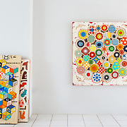 Kaori Takamura, an abstract mixed media artist originally from Japan, will be showing new work at Gebert Contemporary in Scottsdale next month. Her works are inspired by both corporate graphics and early American quilts. She uses laser cut wood, silk screens, thread, fabric.