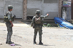 June 2, 2017 - Marawi, Philippines - Philipine marines secure a stronghold position in the village of Mapandi, in Marawi City, southern Philippines. Government troops advance their positions to assault the Islamist Militant Maute group. Photo by: Linus Guardian Escandor II  (Credit Image: © Linus Guardian Escandor Ii via ZUMA Wire)