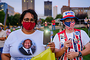 21 JULY 2020 - DES MOINES, IOWA: People hold up cell phones and candles during a memorial and vigil for Congressman John Lewis (D-GA). About 300 people attended a vigil for the Representative Lewis in Poppajohn Sculpture Park in Des Moines Tuesday night. Rep. Lewis died from pancreatic cancer on July 17, 2020.             PHOTO BY JACK KURTZ