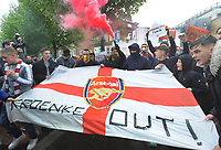 Football - 2020 / 2021 Premier League - Arsenal vs Brighton & Hove Albion - Emirates Stadium<br /> <br /> Arsenal fans protest about the owner, Stan Kroenke outside the stadium with a banner saying 'Kroenke Out'<br /> <br /> Credit : COLORTSPORT/ANDREW COWIE