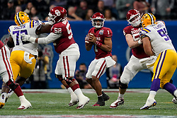 Jalen Hurts #1 of the Oklahoma Sooners drops back to pass during the first half against the LSU Tigers in the 2019 College Football Playoff Semifinal at the Chick-fil-A Peach Bowl on Saturday, Dec. 28, in Atlanta. (Paul Abell via Abell Images for the Chick-fil-A Peach Bowl)