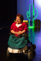 """© Licensed to London News Pictures. 05/10/2015. London, UK. Pictured: Caroline Bowditch. Caroline Bowditch's """"Falling in Love with Frida"""" explores the life, loves and legacy of disabled artist Frida Kahlo at the Lilian Baylis Studio/Sadler's Wells on 5-6 October 2015. Performed by Caroline Bowditch, Welly O'Brien, Nicole Guarino and Yvonne Strain (sign language interpreter). Photo credit: Bettina Strenske/LNP"""