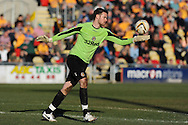 Newport county's goalkeeper Ian McLoughlin in action.  Skybet football league two match, Newport county v Exeter city at Rodney Parade in Newport, South Wales on Sunday 16th March 2014.<br /> pic by Andrew Orchard, Andrew Orchard sports photography.