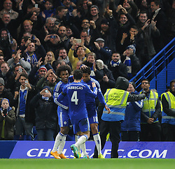 Chelsea's Loic Remy celebrates his goal with Chelsea's Cesc Fabregas and Chelsea's Willian - Photo mandatory by-line: Dougie Allward/JMP - Mobile: 07966 386802 - 03/12/2014 - SPORT - Football - London - Stamford Bridge - Chelsea v Tottenham Hotspur - Barclays Premier League