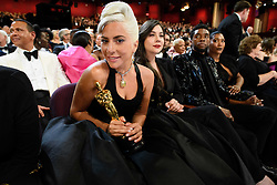After winning the Oscar® for music written for motion pictures (original song), Lady Gaga, and Anthony Rossomando poses with her Oscar® during the live ABC Telecast of The 91st Oscars® at the Dolby® Theatre in Hollywood, CA on Sunday, February 24, 2019.