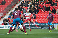 Doncaster Rovers Midfielder James Coppinger (26) crosses the ball into the box during the The FA Cup match between Doncaster Rovers and Scunthorpe United at the Keepmoat Stadium, Doncaster, England on 3 December 2017. Photo by Craig Zadoroznyj.