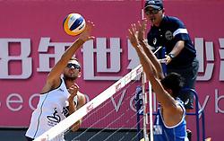 QINZHOU, Oct. 2, 2018  Arnaud Gauthier-Rat of France (L) competes against Gao Peng of China during the men's Pool A match between Gao Peng/Li Yang of China and Quincy Aye/Arnaud Gauthier-Rat of France at the FIVB Beach Volleyball World Tour in Qinzhou, south China's Guangxi Zhuang Autonomous Region, Oct. 2, 2018. France won 2-0. (Credit Image: © Zhang Ailin/Xinhua via ZUMA Wire)