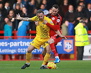 Crawley Town striker Rhys Murphy & Bristol Rovers midfielder Stuart Sinclair tussle for possession during the Sky Bet League 2 match between Crawley Town and Bristol Rovers at the Checkatrade.com Stadium, Crawley, England on 21 November 2015. Photo by Bennett Dean.