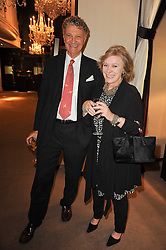 The HON.WILLIAM SHAWCROSS and JULIA TWIGG at a party to celebrate the publication of Inheritance by Tara Palmer-Tomkinson at Asprey, 167 New Bond Street, London on 28th September 2010.