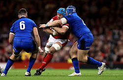 Wales' Justin Tipuric is tackled by Italy's Luca Bigi during the Guinness Six Nations match at the Principality Stadium, Cardiff.