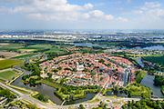 Nederland, Zuid-Holland, Brielle, 10-06-2015; Voorne-Putten met vestingstadje Brielle, vroeger Den Briel. Overzicht van de vesting met Sint Catharijnekerk. Haven van Rotterdam in de achtergrond.<br /> Former isle of Voorne and the fortified town of Brielle. Port of Rotterdam in the background.<br /> luchtfoto (toeslag op standard tarieven);<br /> aerial photo (additional fee required);<br /> copyright foto/photo Siebe Swart<br /> ---------------------------------------------