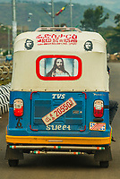 A tuk tuk with images of Jesus Christ and Che Guevara on it, Arba Minch, Ethiopia.