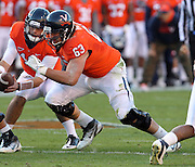 CHARLOTTESVILLE, VA- NOVEMBER 12: Guard Austin Pasztor #63 of the Virginia Cavaliers moves off the line during the game against the Duke Blue Devils on November 12, 2011 at Scott Stadium in Charlottesville, Virginia. Virginia defeated Duke 31-21. (Photo by Andrew Shurtleff/Getty Images) *** Local Caption *** Austin Pasztor