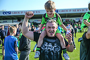 FGR supporter celebrating with his son during the Vanarama National League Play Off second leg match between Forest Green Rovers and Dagenham and Redbridge at the New Lawn, Forest Green, United Kingdom on 7 May 2017. Photo by Shane Healey.
