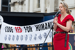 London, UK. 23rd August, 2021. Dr Gail Bradbrook, co-founder of Extinction Rebellion, addresses fellow environmental activists in Trafalgar Square during the first day of Impossible Rebellion protests. Extinction Rebellion are calling on the UK government to cease all new fossil fuel investment with immediate effect. Credit: Mark Kerrison/Alamy Live News