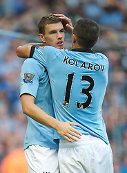 01.09.2012, Etihad Stadion, Manchester, ENG, Premier League, Manchester City vs Queens Park Rangers, 2. Runde, im Bild Manchester City's Edin Dzeko celebrates scoring the second goal against Queens Park Rangers with Aleksandar Kolarov during the English Premier League 2nd round match between Manchester City and Queens Park Rangers at the Etihad Stadium, Manchester, Great Britain on 2012/09/01. EXPA Pictures © 2012, PhotoCredit: EXPA/ Propagandaphoto/ David Rawcliff..***** ATTENTION - OUT OF ENG, GBR, UK *****