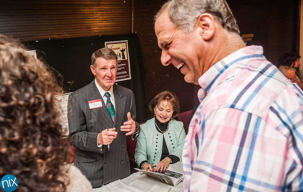 """Robert Tucker, center, owner of Shoe Show, during Legendary Locals Day at the Old Courthouse Theatre in Concord Sunday afternoon. The various """"legendary celebrities"""" are from historian Michael Eury's new book """"Legendary Locals of Concord."""""""