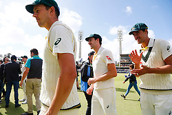 Australia's Josh Hazelwood,Pat Cummins and Mitchell Starc celebrates winning the Ashes during day five of the Ashes Test match at the WACA Ground, Perth.