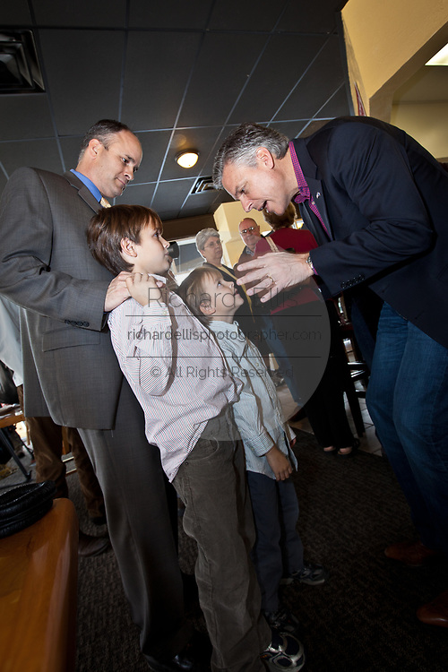Republican presidential candidate Gov. Jon Huntsman of Utah talks to two young boys during a breakfast event at the Honeycomb Cafe on Daniel Island January 12, 2012 in Charleston, South Carolina.