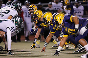 Milpitas' defensive line waits for the snap during the CCS Division 1 playoff game against No. 7 Homestead at Milpitas High School in Milpitas, California, on November 22, 2013. No. 2 Milpitas beat Homestead 62-28. (Stan Olszewski/SOSKIphoto)