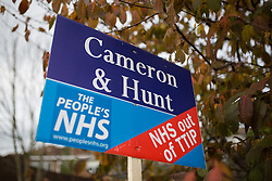"© Licensed to London News Pictures . 17/11/2014 . Kent , UK . Mock estate agent board calling for "" NHS out of TTIP "" and referencing Prime Minister David Cameron and Health Secretery Jeremy Hunt , outside a house in Strood . Photo credit : Joel Goodman/LNP"