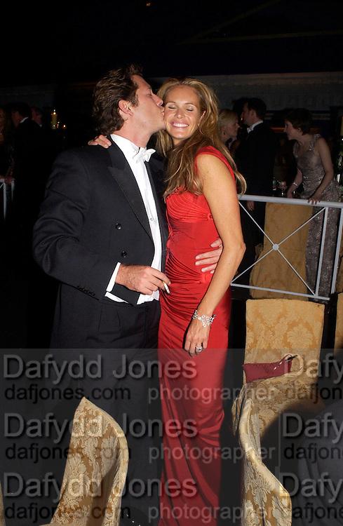 Arpad Busson and Elle Macpherson, Sir Elton John's White Tie and Tiara Ball. Windsor, 28 June 2003. © Copyright Photograph by Dafydd Jones 66 Stockwell Park Rd. London SW9 0DA Tel 020 7733 0108 www.dafjones.com