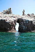 Isla Espíritu Santo (Espiritu Santo Island) is a large (102 km2) island surrounded by a set of smaller islets known as Isla Partida, Los Islotes, La Ballena, El Gallo and La Gallina. It lies some 20 km east of La Paz in Baja California Sur, Mexico. Because of its proximity to La Paz Bay, the island has been intensely used in the past and is still the most heavily visited island in the Sea of Cortés. It is littered with evidence of pre-Hispanic occupancy by the Pericú people. In the 19th century Don Gastón Vivés established the first pearl oyster farm in the world here.<br />