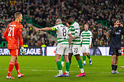 Celtic Captain Scott Brown pushes Karl-Johan Johnsson of FC Copenhagen back from the penalty spot as Odsonne Edouard of Celtic FC places the ball on the spot during the Europa League match between Celtic and FC Copenhagen at Celtic Park, Glasgow, Scotland on 27 February 2020.