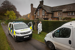 © Licensed to London News Pictures. 24/10/2020. Christmas Common, UK. A police forensics investigator works at a house at Christmas Common where it is reported that a man entered the property and was found naked by the home owner - after the body of a woman was found on Friday 23rd October at nearby Watlington Hill. An injured man was arrested by police nearby after a man was seen acting suspiciously in a pub. Photo credit: Peter Macdiarmid/LNP