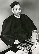 'Idris, GBE (1969-1983) also known King Idris I of Libya (9151-1969) broadcasting Libyan Independence, 24 December 1951.  Born Muhammad Idris bin Muhammad al-Mahdi as-Senussi.'